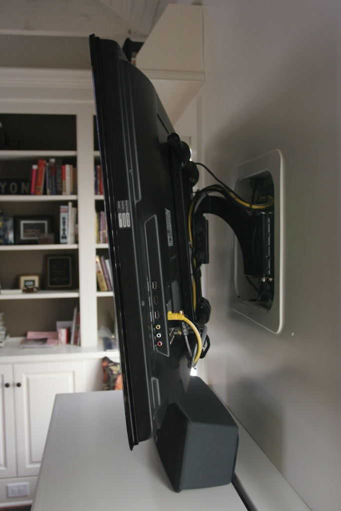 """New construction in office allowed installation of recessed Sanus TV mount for 46"""" LCD TV."""